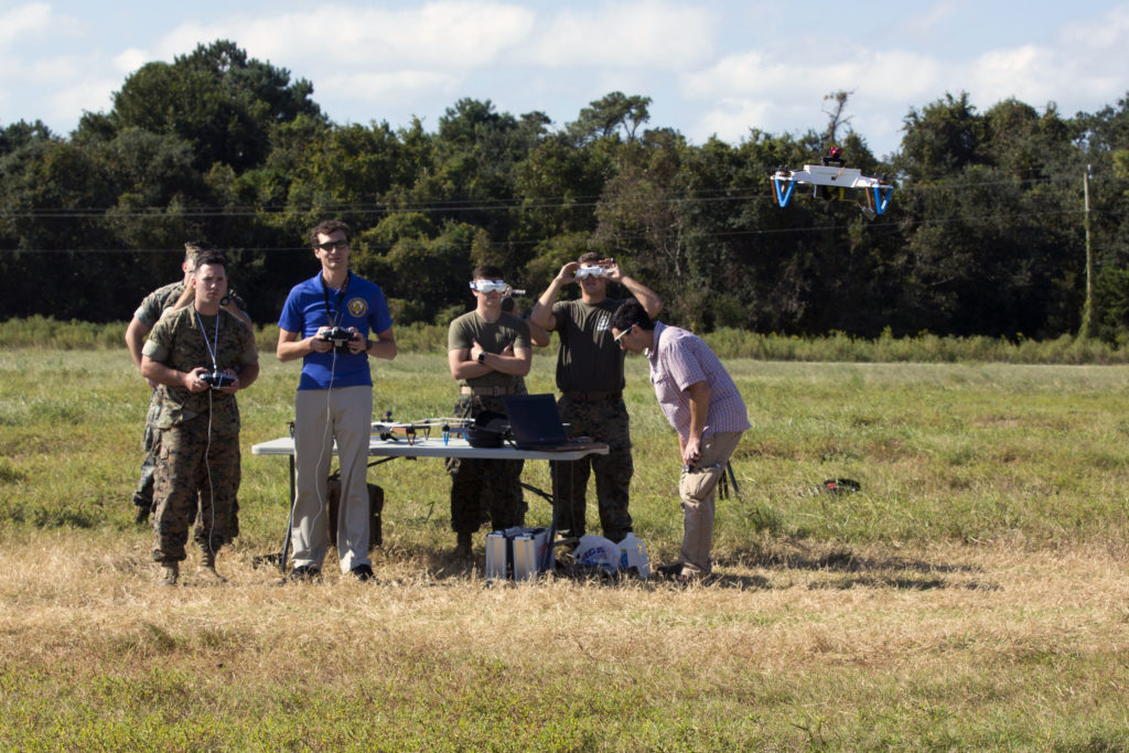 U.S. Marines with 2nd Marine Division, fly 3D printed unmanned aircraft system (ODSUAS small) with a civilian contractor on Camp Lejeune, N.C., August 27, 2017. The ODSUAS drone was created through 3D printing to be low cost, easily repaired, and have simple maintenance to allow Marines to use forward deployed. (U.S. Marine Corps photo by Cpl. John A. Hamilton Jr.)